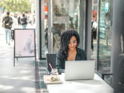 A woman using her laptop outdoors